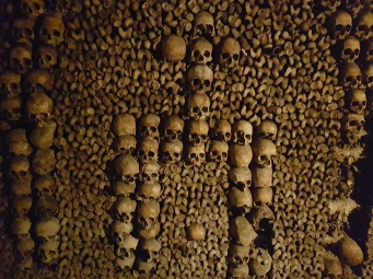Skull patterns made with the bones in the Catacombs of Paris