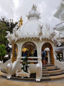 Ornately decorated gazebo covering the wishing well.