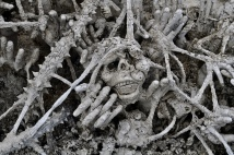 Skulls and hands reaching up from Hell
