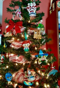Our tree filled with travel ornaments